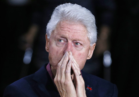 Former President Bill Clinton listens to Democratic presidential candidate Hillary Clinton speak during a rally Friday, Feb. 19, 2016, in Las Vegas. (AP Photo/John Locher)