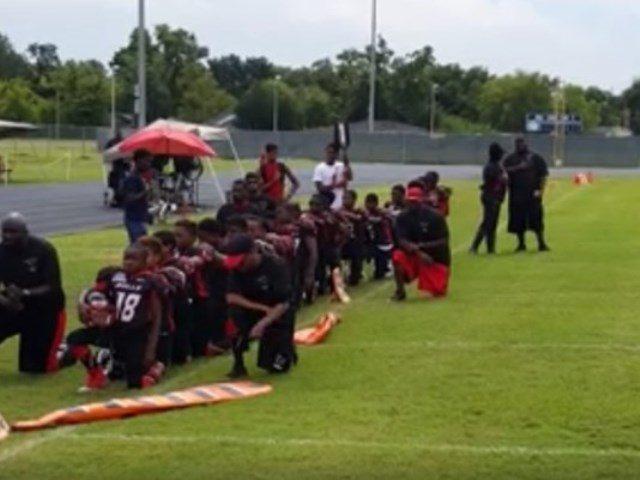 black-football-youths-take-a-knee